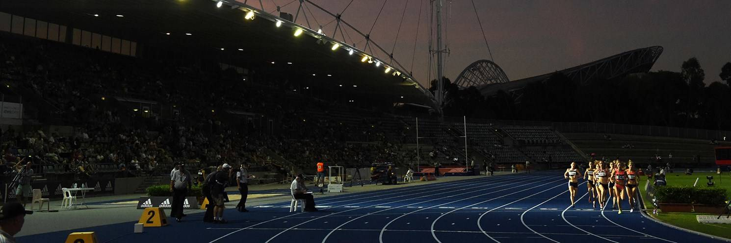 Sydney Olympic Park Athletics Centre - Runners at the Australian Athletics championships during twilight - Photo by Delly Carr